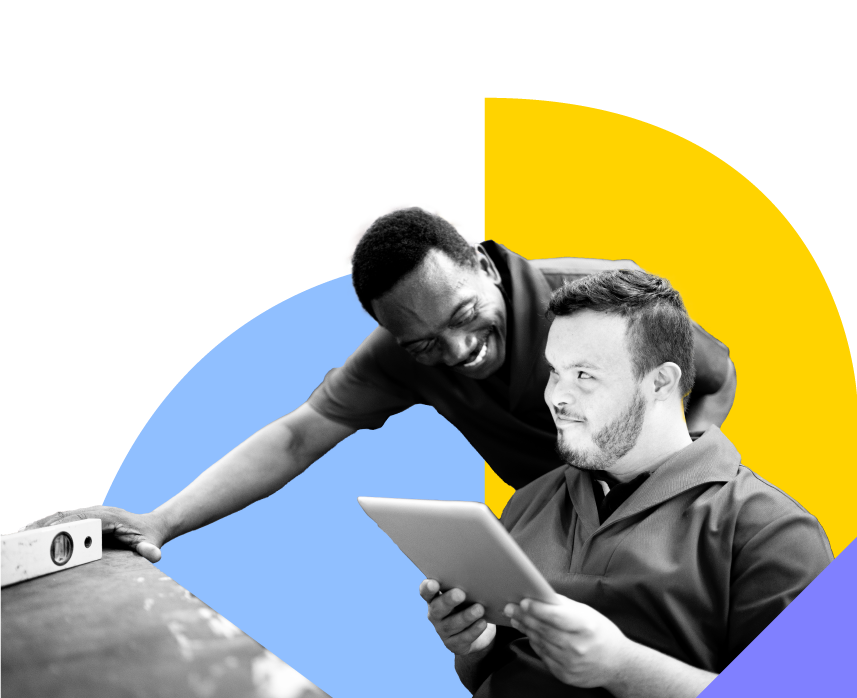 Man leaning down next to another man holding a tablet   SETWorks employment services software
