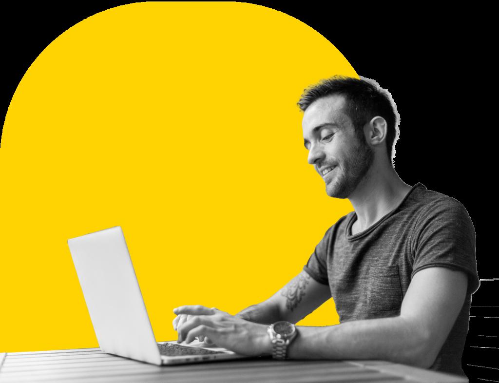 Man sitting at a laptop computer.