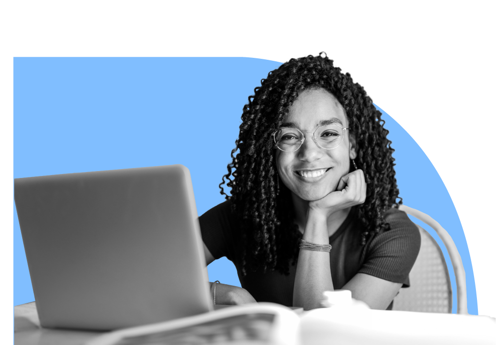 Woman smiling in front of laptop computer.