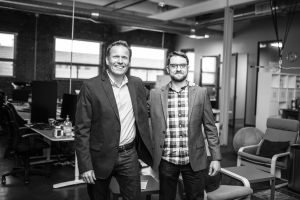 SETWorks team memberse Henri and David smiling in office building in Kansas City, MO.